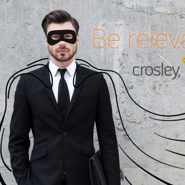 Crosley Website Design and Development, photo of a man in business suit with cape and mask drawn on, crosley inc. logo