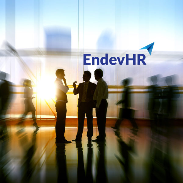 EndevHR Logo Design against blurred photo of business men in a meeting