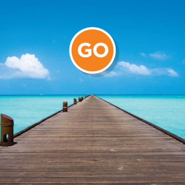 The Greater Go Website and Brand Design, Orange circle with GO in white floating in a blue sky above long wooden dock that stretches into the middle of a clear turquoise ocean