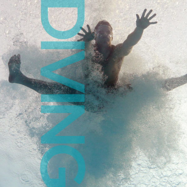 USA Diving Magazine Publication Design, magazine cover featuring male diver under water, spread eagle in a cloud of tiny bubbles